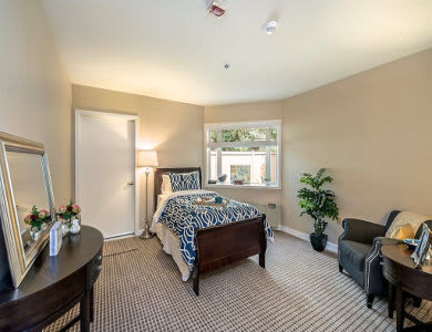 Well decorated bedroom in Pacifica Senior Living Lynnwood