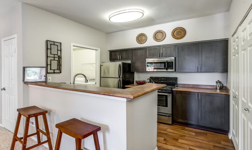 brown renovation Kitchen at HighGrove Apartments in Everett