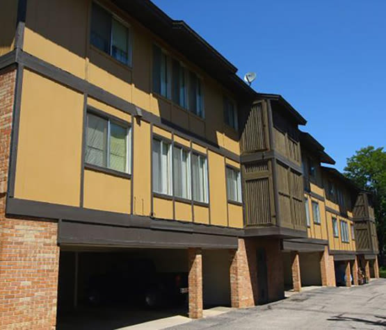 Exterior view of resident building at Forest Cove Apartments