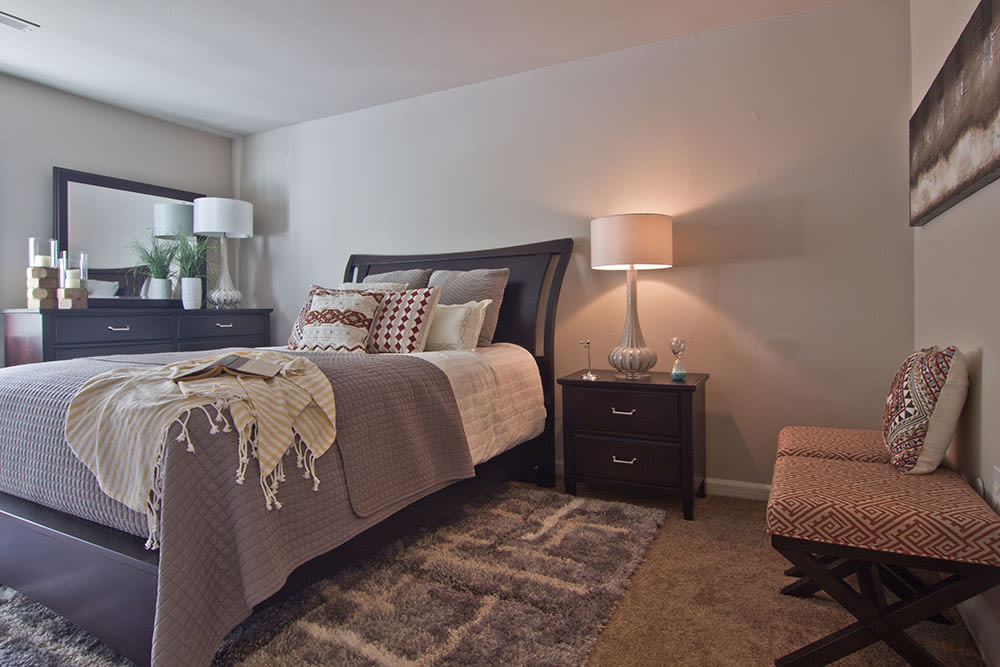 Enjoy apartments with a cozy bedroom at Eagle's Crest Apartments