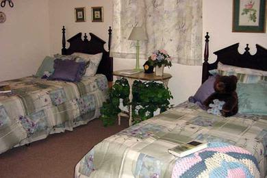 Comfortable bedroom in Pacifica Senior Living Belleair
