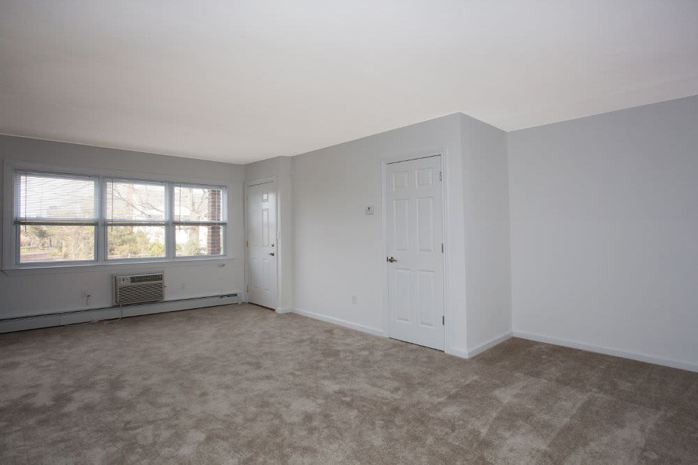 Spacious living room at Monmouth Beach Village Apartment Homes in Long Branch, NJ