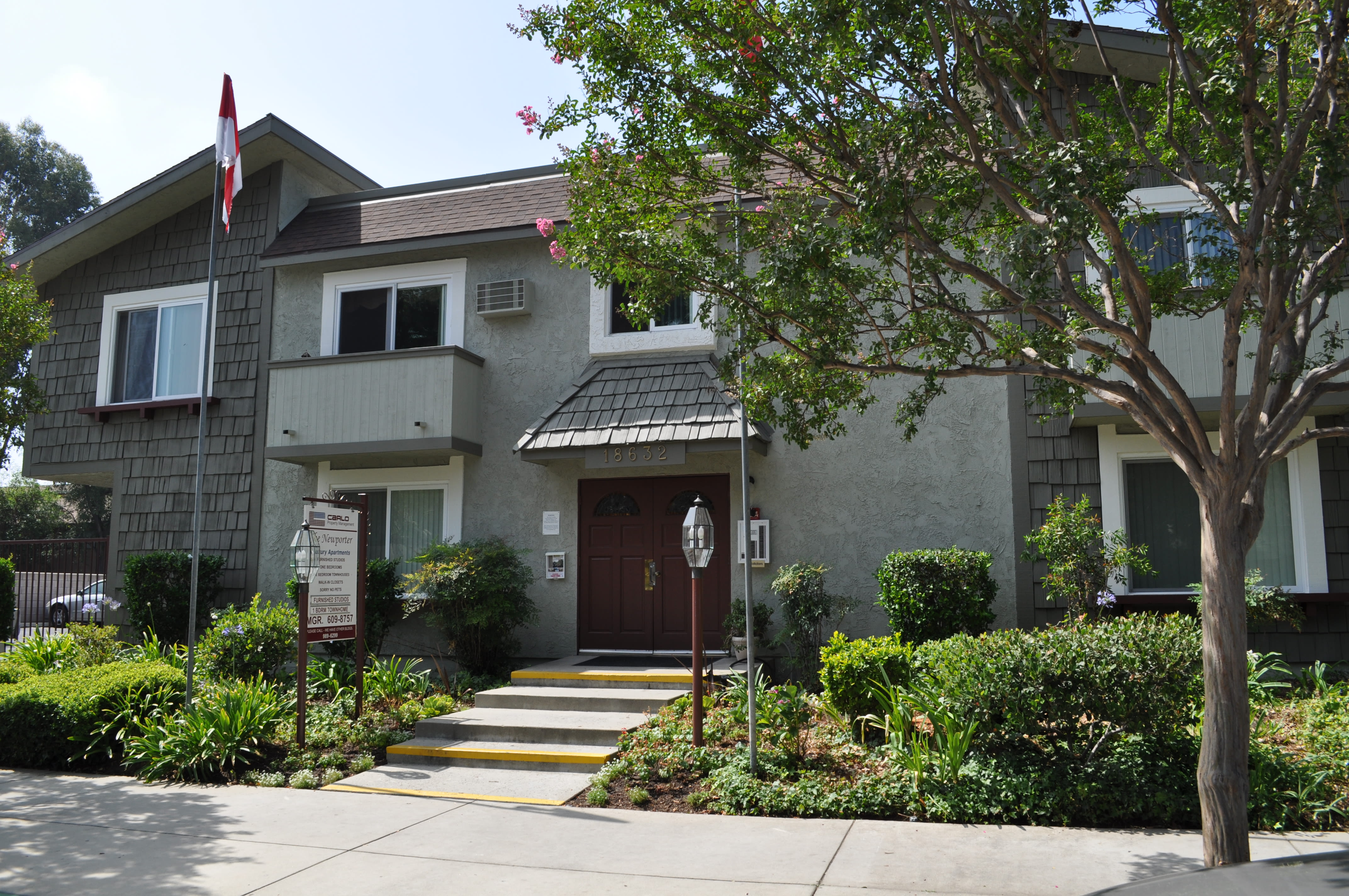 Exterior of building with entrance at The Newporter in Tarzana, California
