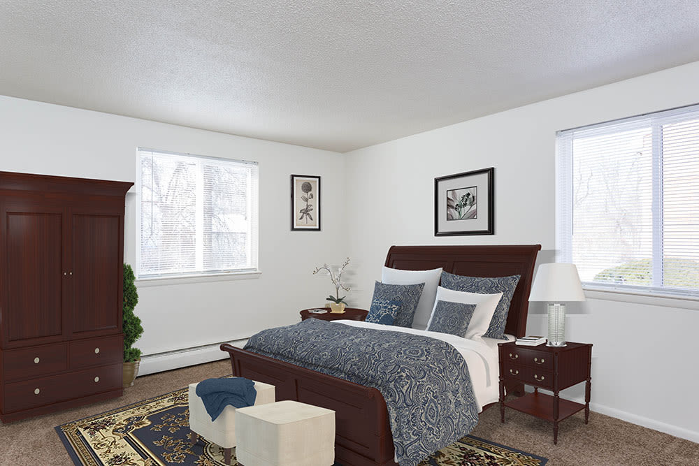 Luxury bedroom at Perinton Manor Apartments in Fairport, New York