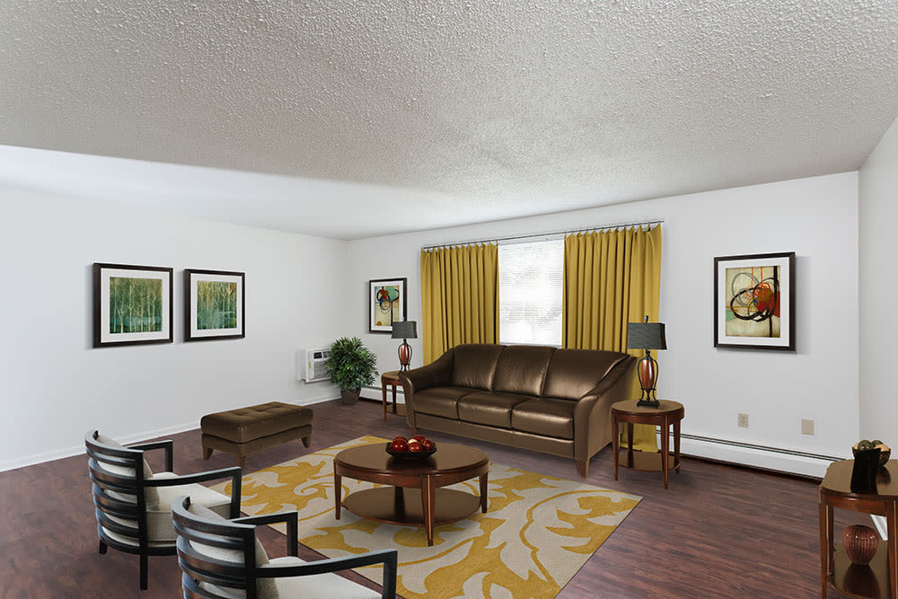 Spacious living room at Perinton Manor Apartments in Fairport, NY