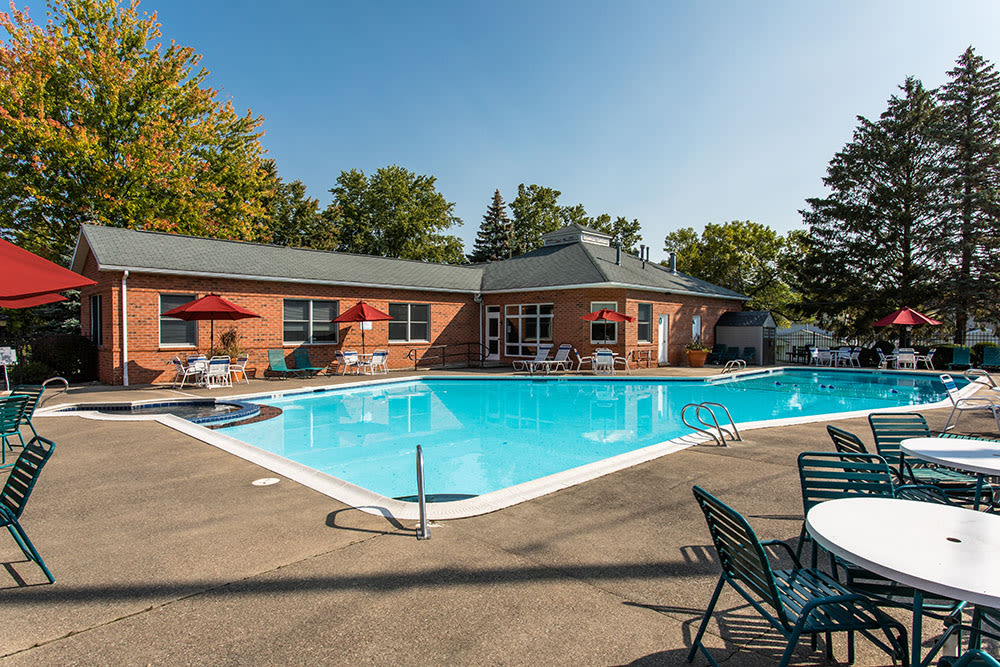A swimming pool that is great for entertaining at Perinton Manor Apartments in Fairport, New York