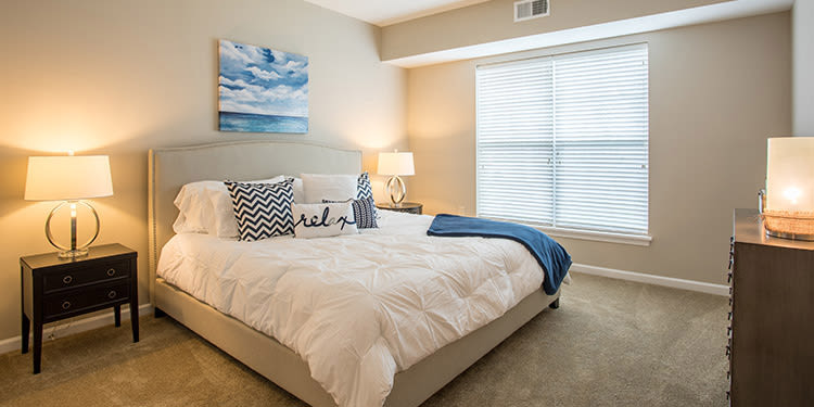 Well decorated bedroom at The Landings at Meadowood in Baldwinsville