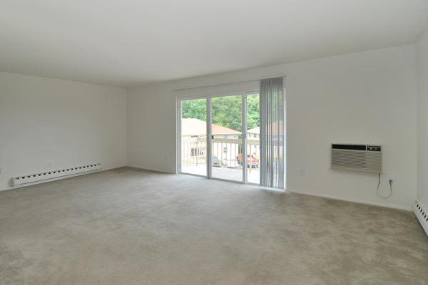 Spacious living room at Whitestone Village Apartment Homes in Allentown, PA