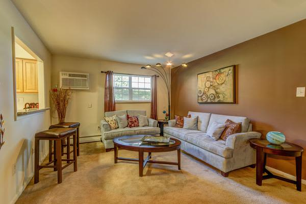 Beautiful living room at Woodacres Apartment Homes in Claymont, DE