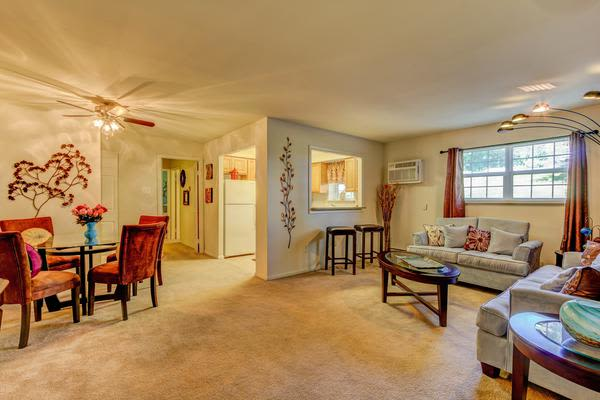 Beautiful living room and dining room at Woodacres Apartment Homes in Claymont, DE