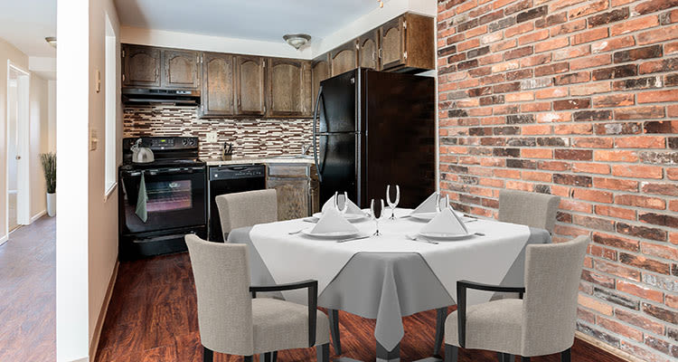 Well-equipped kitchen and dining room at Raintree Island Apartments home in Tonawanda