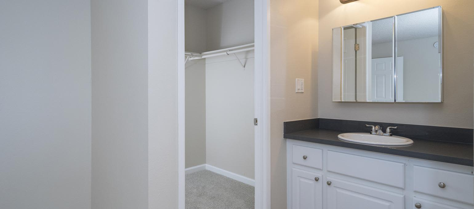 Bathroom and closet at Valley Ridge Apartment Homes in Martinez, California