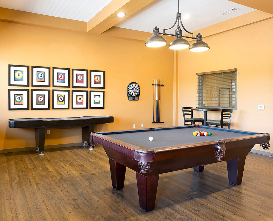 Pool table and shuffle board at Affinity at Wells Branch