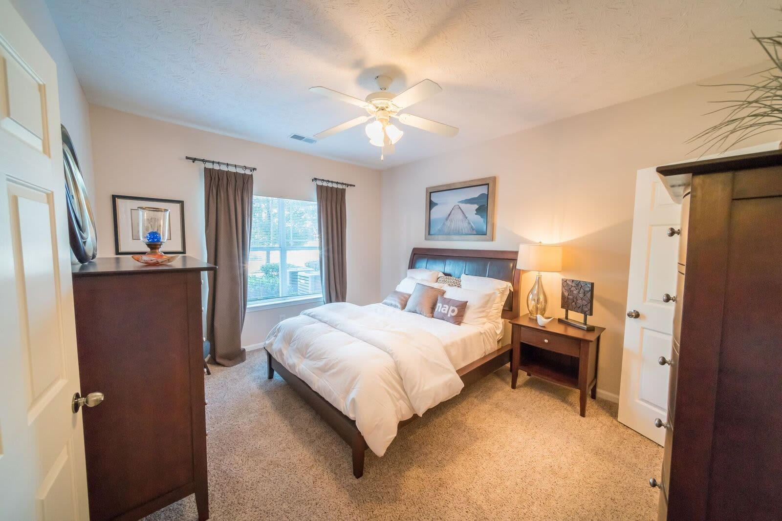 Cozy bedroom at apartments in McDonough, Georgia