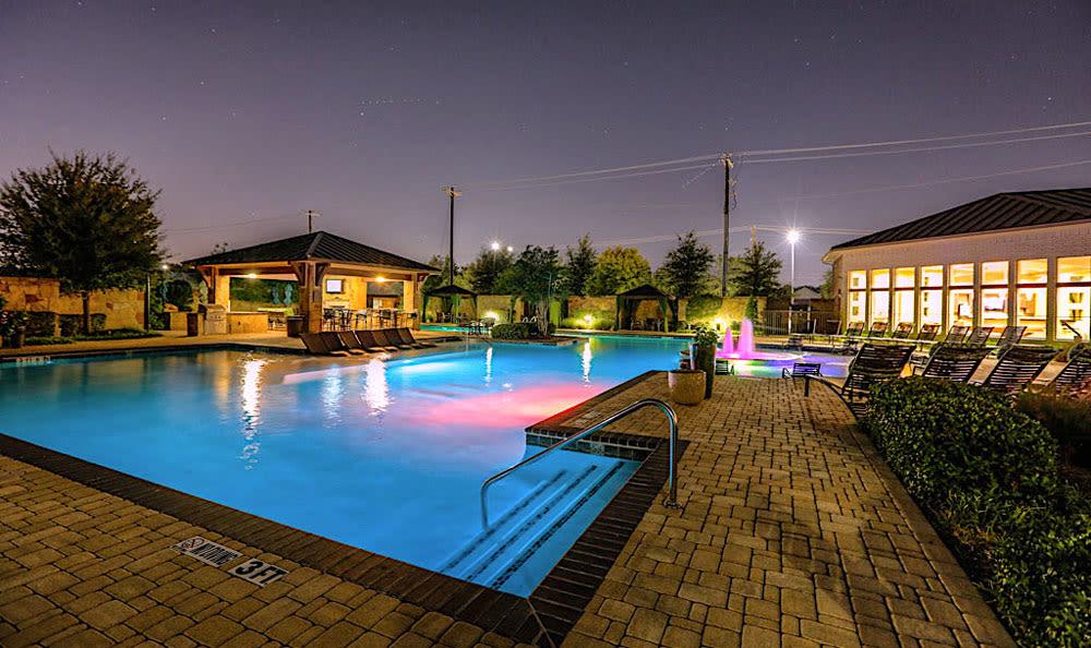 Pool at night at Discovery at Rowlett Creek