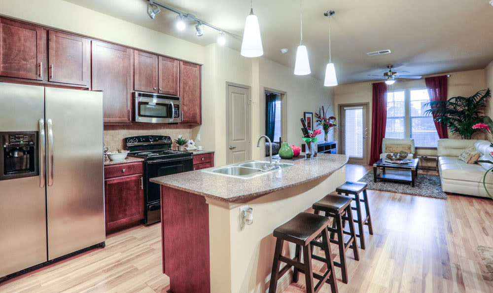 Kitchen with center island at Discovery at Rowlett Creek