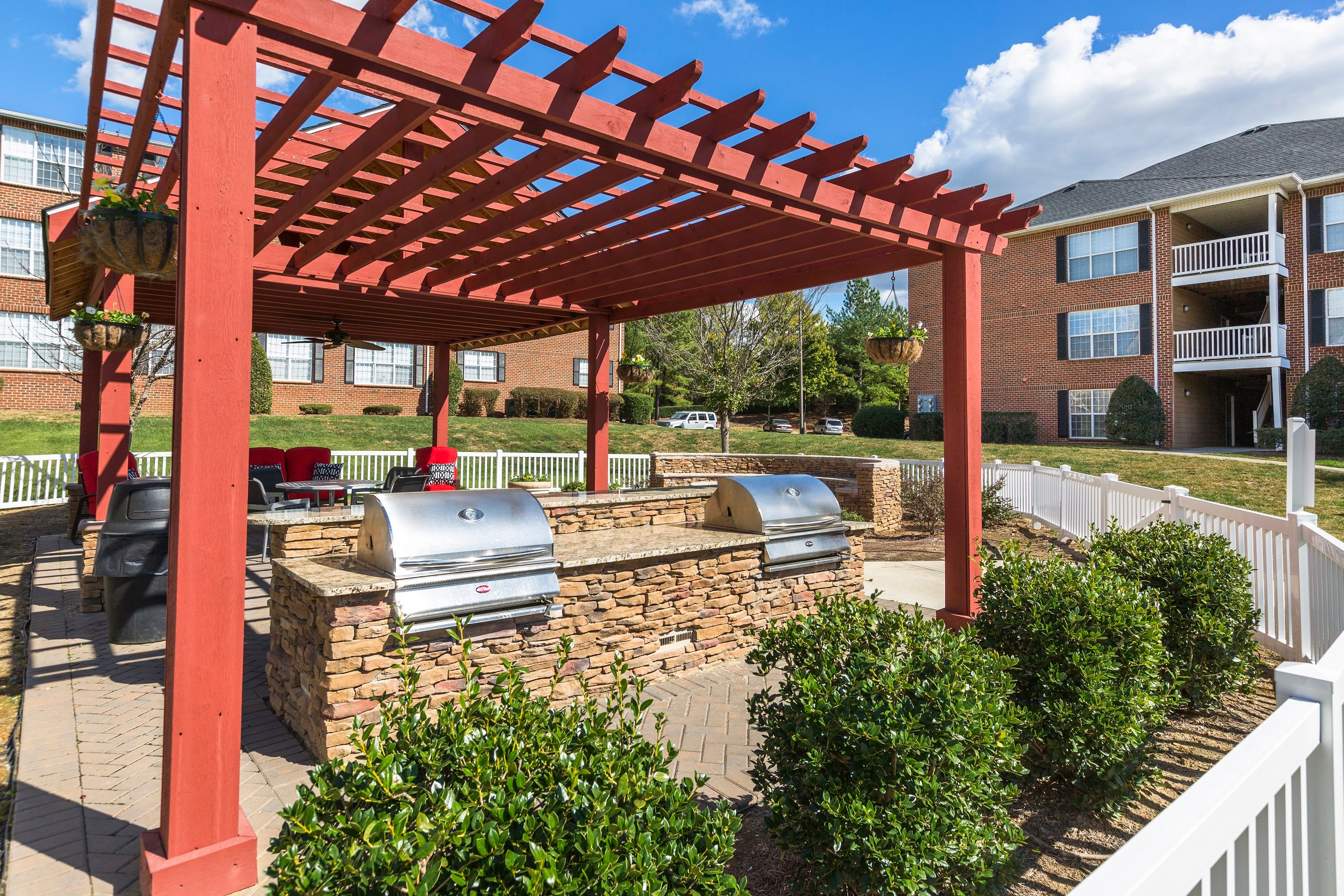 Outdoor patio and grill at Grand Reserve at Pavilions In Charlotte NC