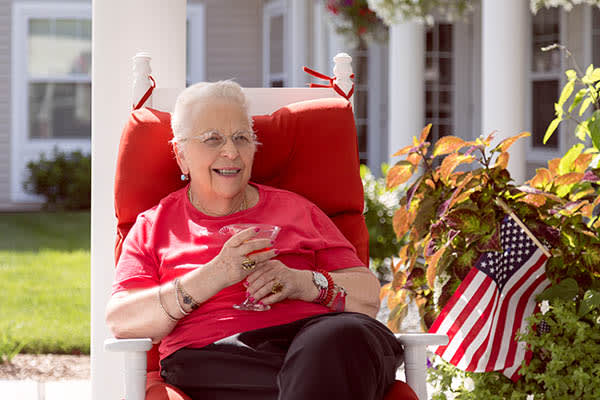Happy woman outside on a sunny day at All American Assisted Living at Washington Township
