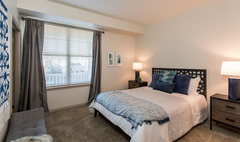 Beautiful bedroom at Fairview at Town Center Apartment Homes in Rochester, New York