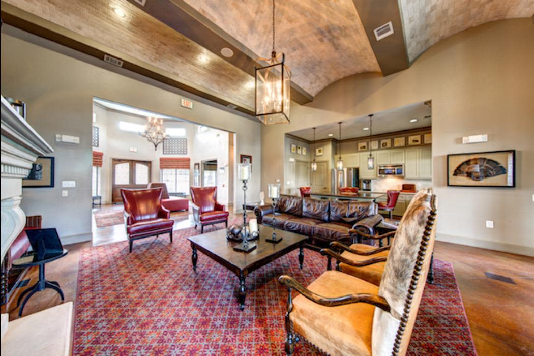 Relax by the fireplace at Marquis Grand Lakes in Richmond, TX