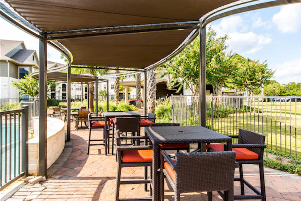 Outdoor seating area at Marquis Grand Lakes in Richmond, TX