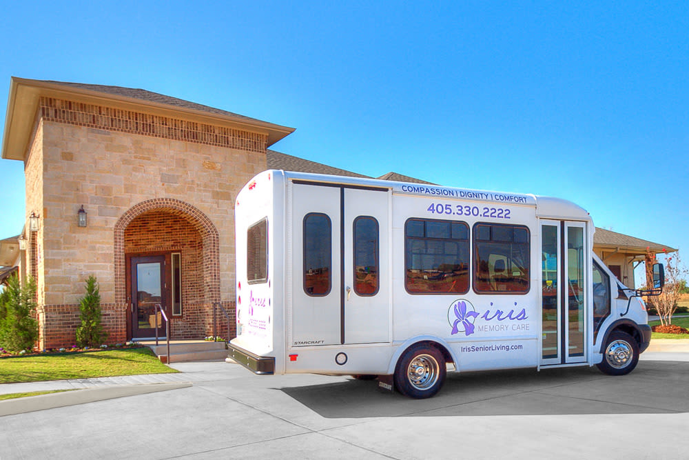 Beautiful exterior and our bus at Iris Memory Care of Edmond in Edmond
