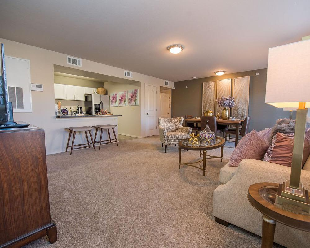 Spacious living room at Watercress Apartments in Maize