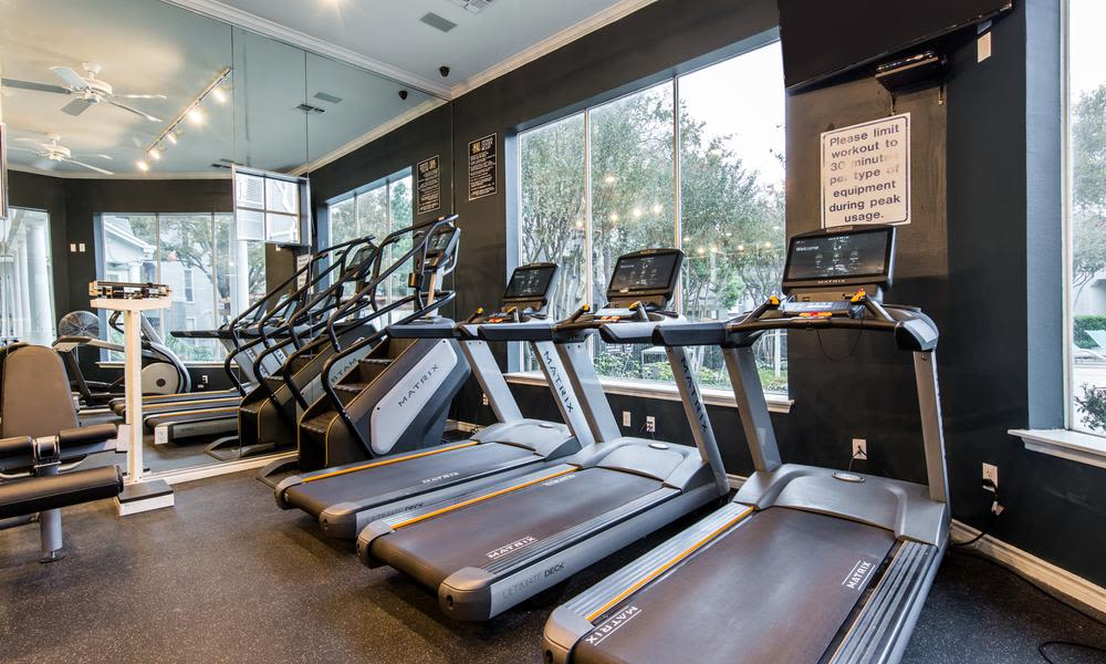 Gym with comfortable spaces at Marquis at Stonegate in Fort Worth