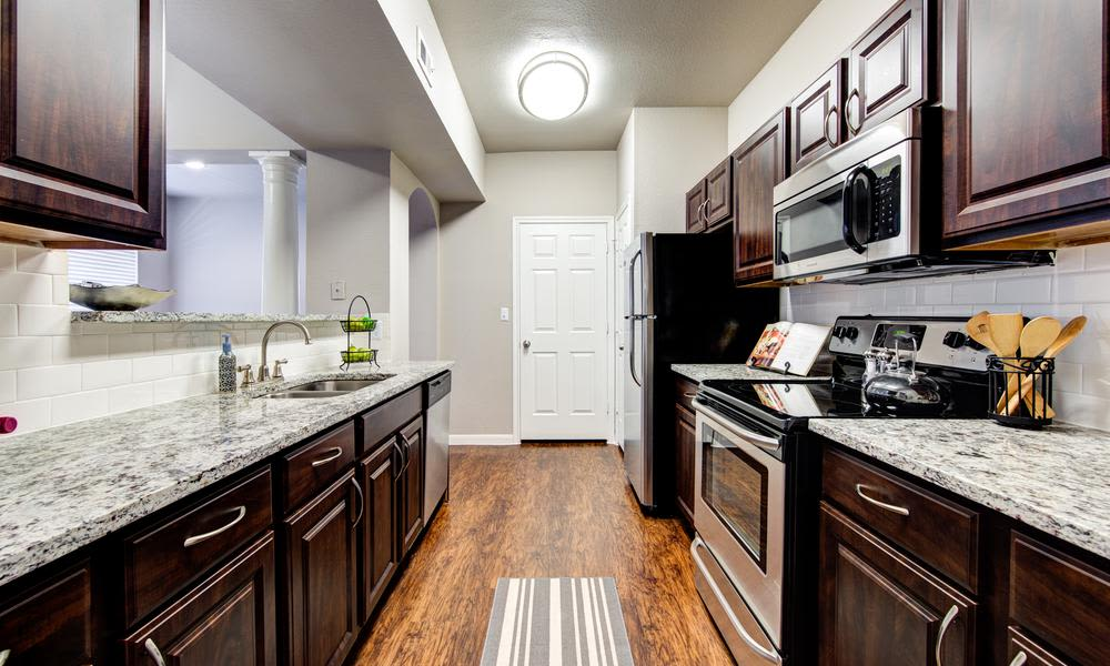 The beautiful kitchen available to residents at Marquis at Stonegate