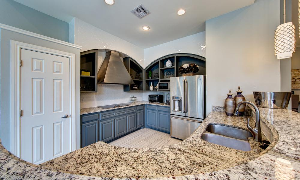 Another view of the kitchen in an example apartment at Marquis at Stonegate