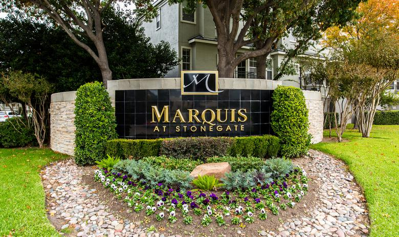 Entrance sign at apartments Marquis at Stonegate in Fort Worth