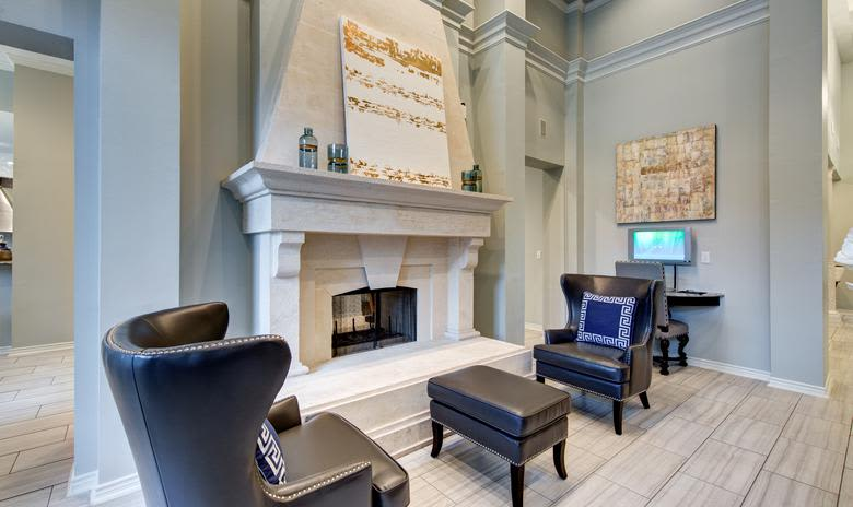 Clubhouse fireplace with some comfy chairs at Marquis at Stonegate