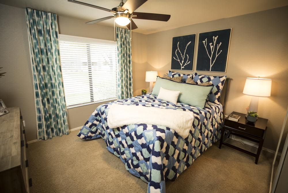 Enjoy our comfortable bedroom at San Valiente Luxury Apartment Homes in Phoenix, AZ
