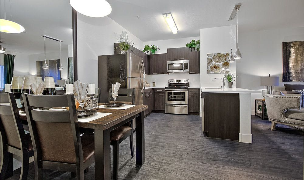 View of modern kitchen from dining room in model apartment at Union Apartments in Las Vegas