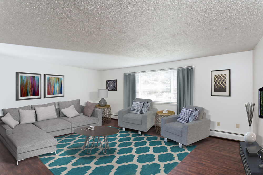 Beautifully designed living room at Perinton Manor Apartments in Fairport