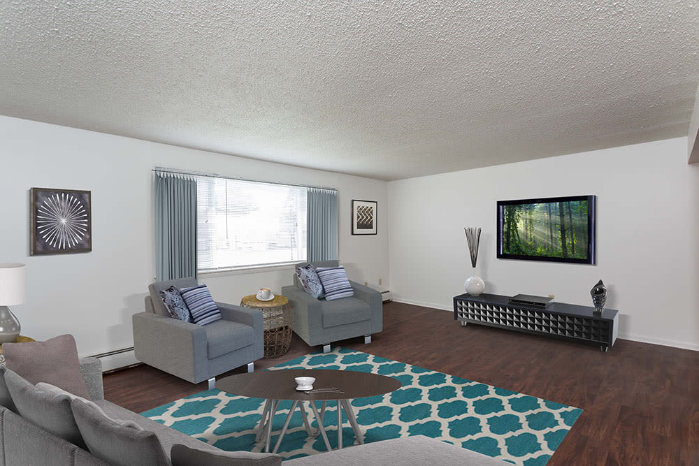 Spacious living room at Perinton Manor Apartments in Fairport, New York