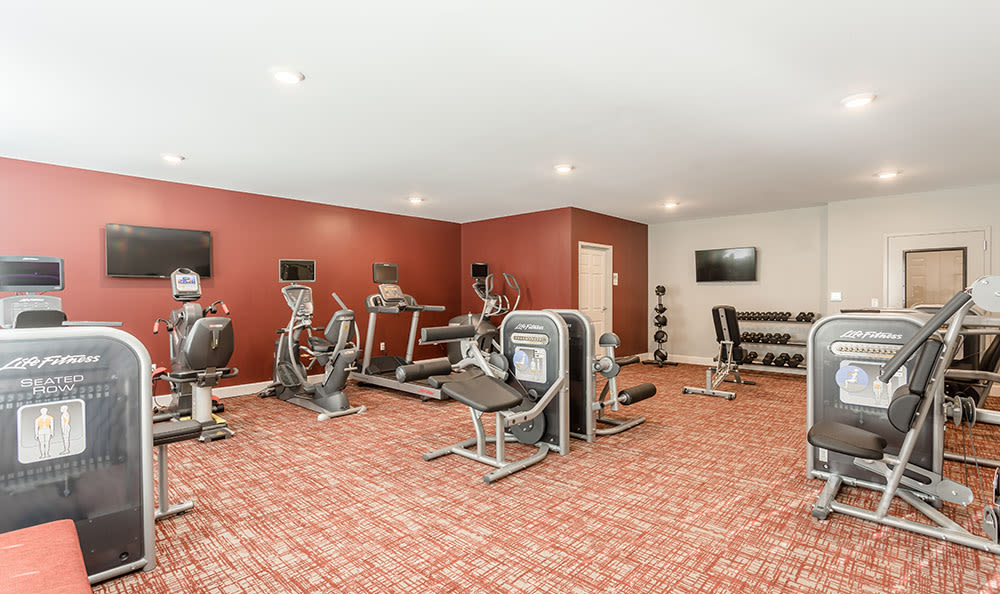 Fitness center at apartments in Fairport