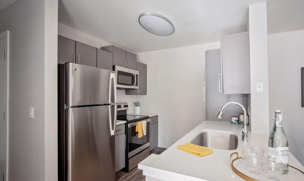 Kitchen with new appliances at apartments in Beaverton, Oregon