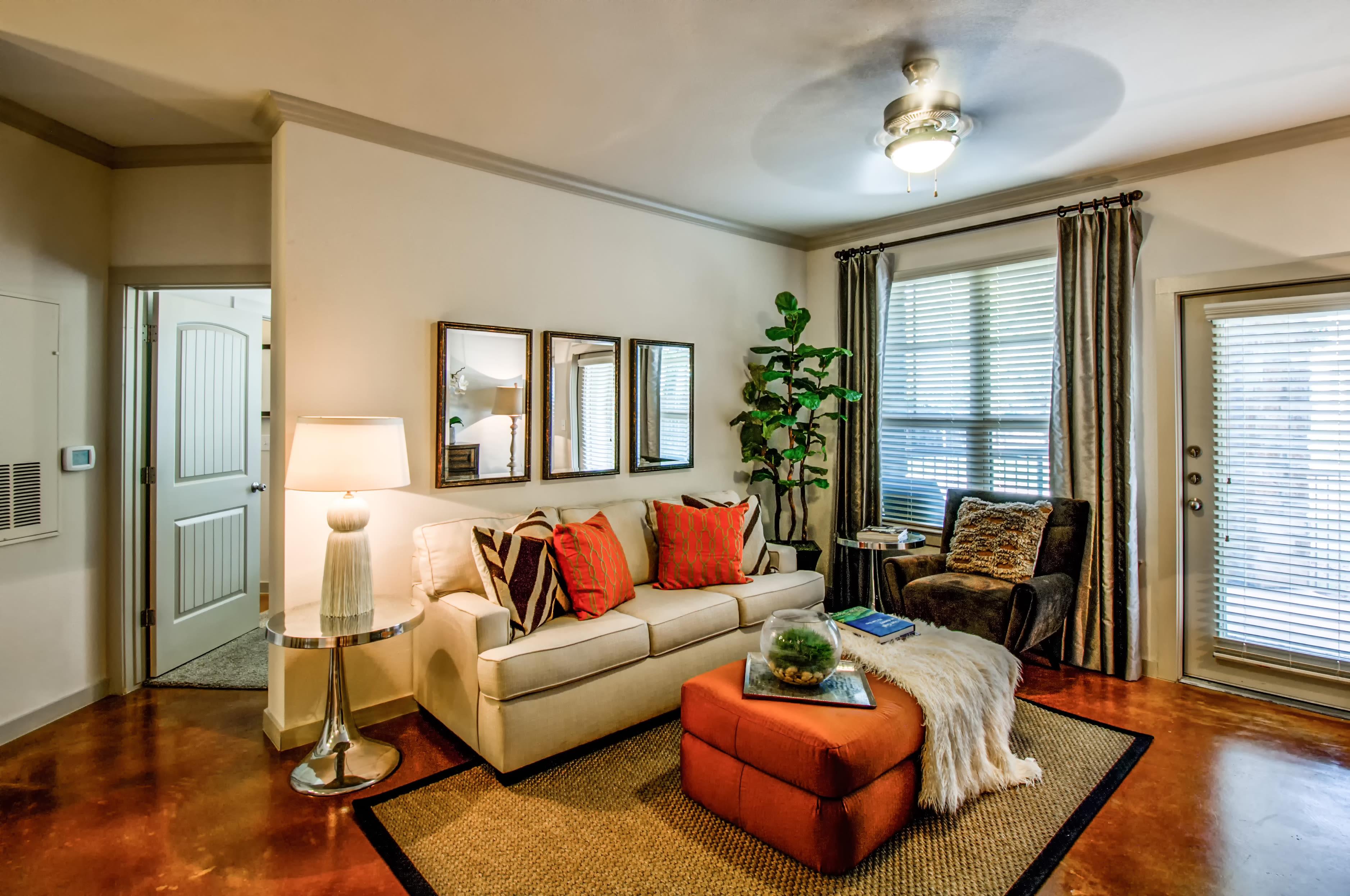 Well lit living room at Firewheel Apartments in San Antonio