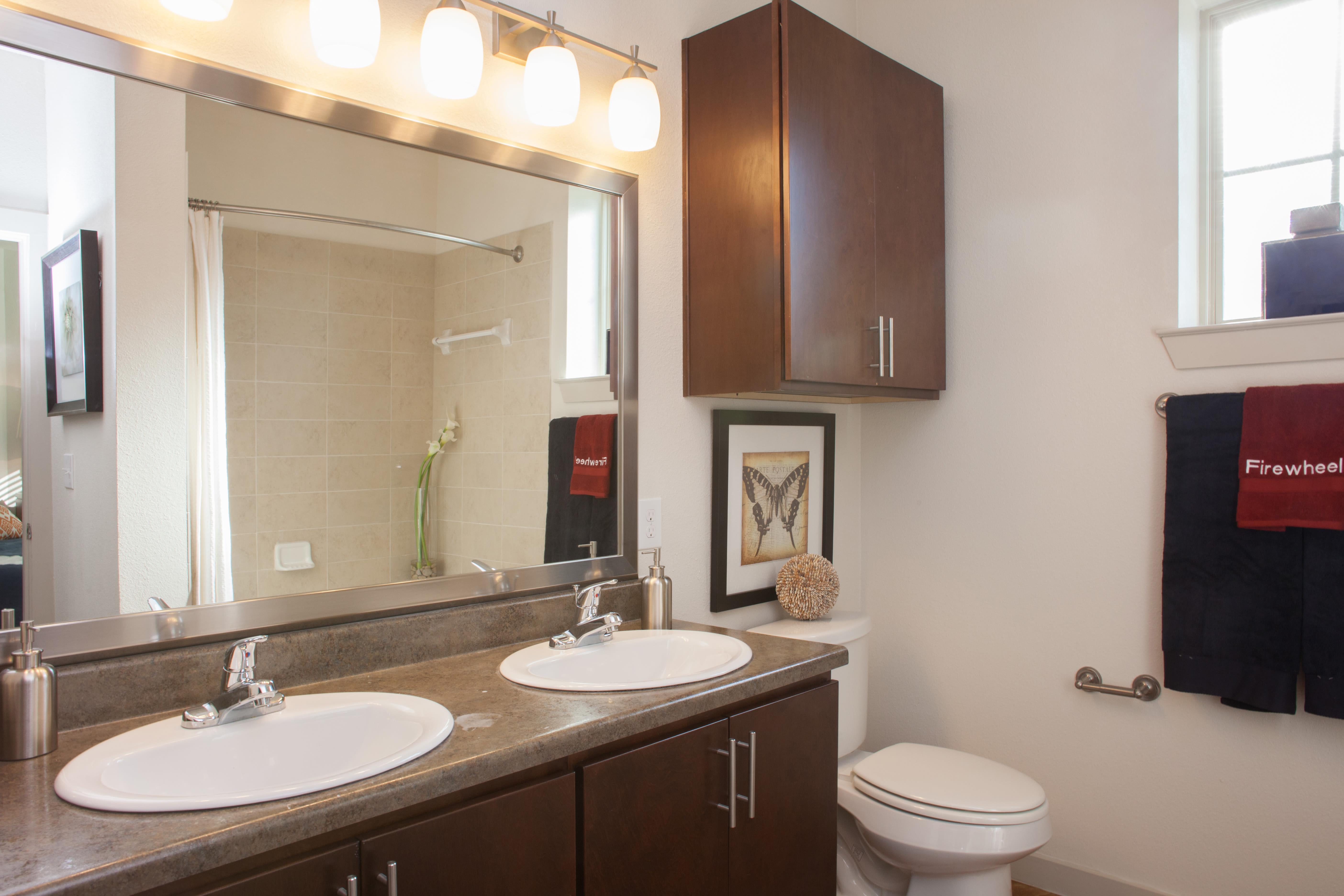 Two sinks in main bathroom at Firewheel Apartments in San Antonio