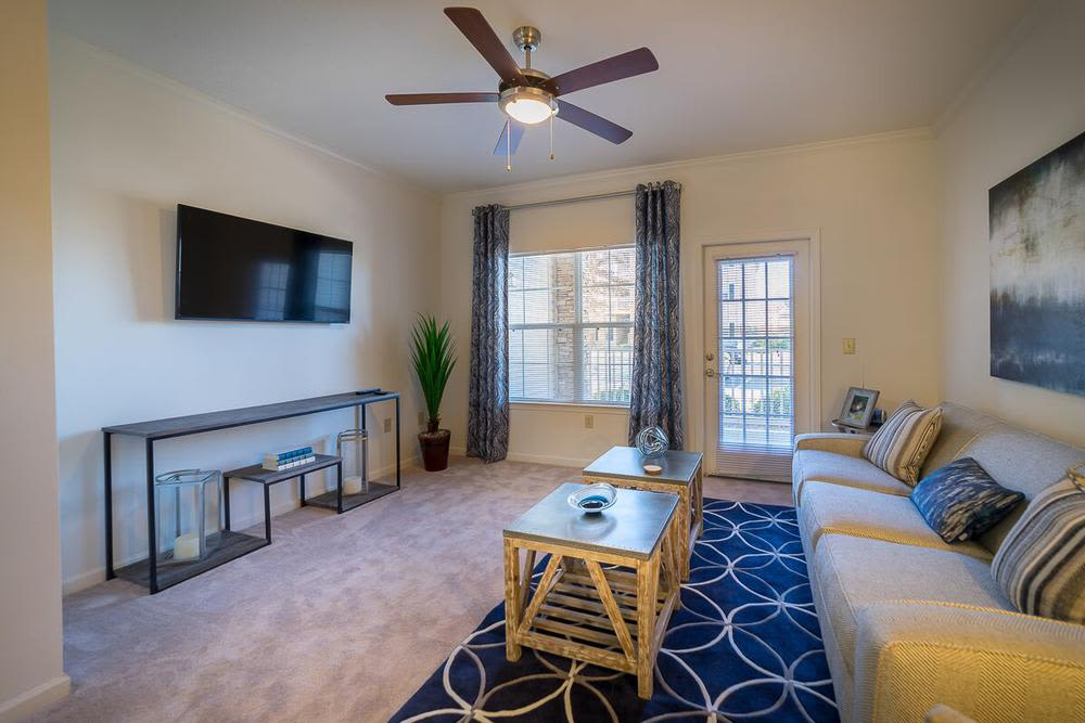 Cozy living room at The Enclave at Deep River in Greensboro, North Carolina