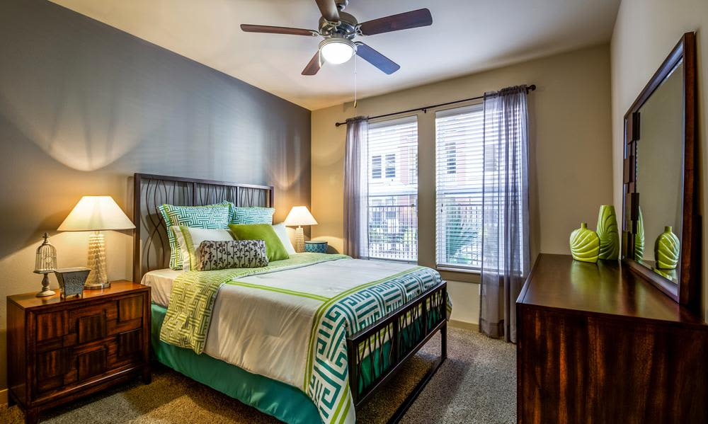 Modern bedroom at 4000 Hulen Urban Apartment Homes in Fort Worth, Texas