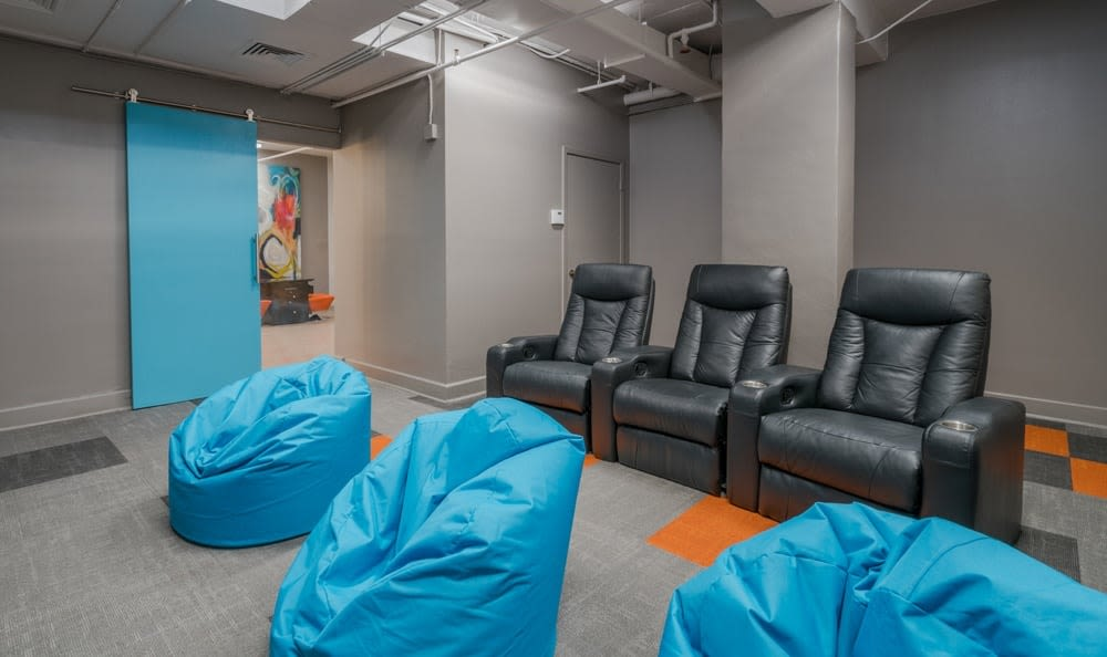 Theater room at The Enclave at 1550 Apartments