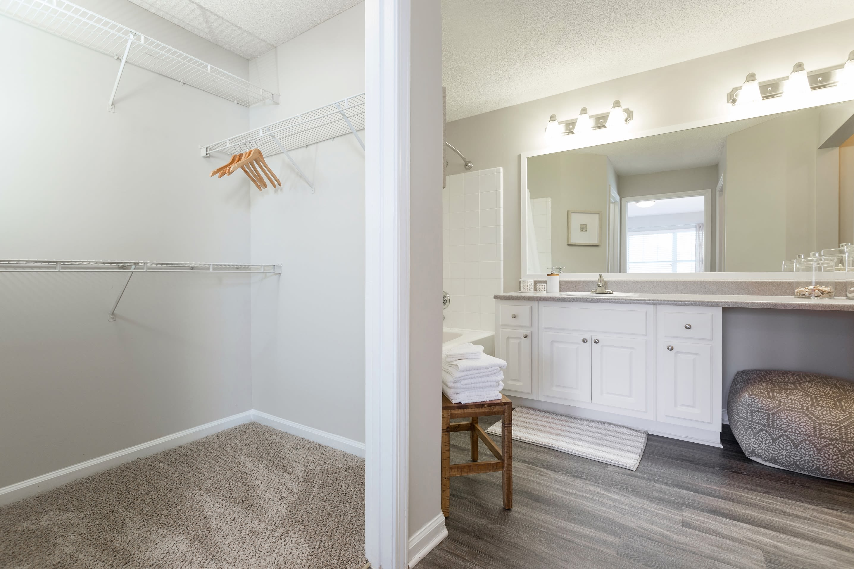 Bathroom with walk in closet at Belle Vista Apartment Homes in Lithonia, GA.