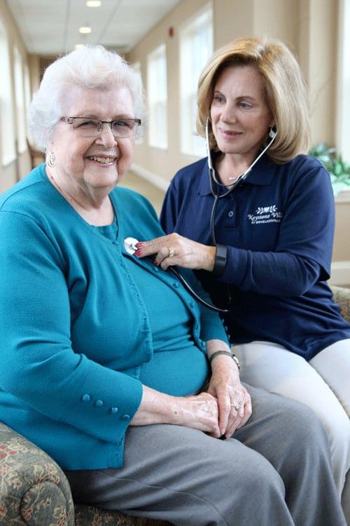 Woman with cat enjoying Keystone Villa at Douglassville assisted living