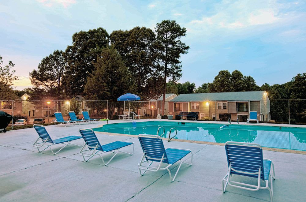 Swimming pool at Woods of Williamsburg Apartments in Williamsburg, VA