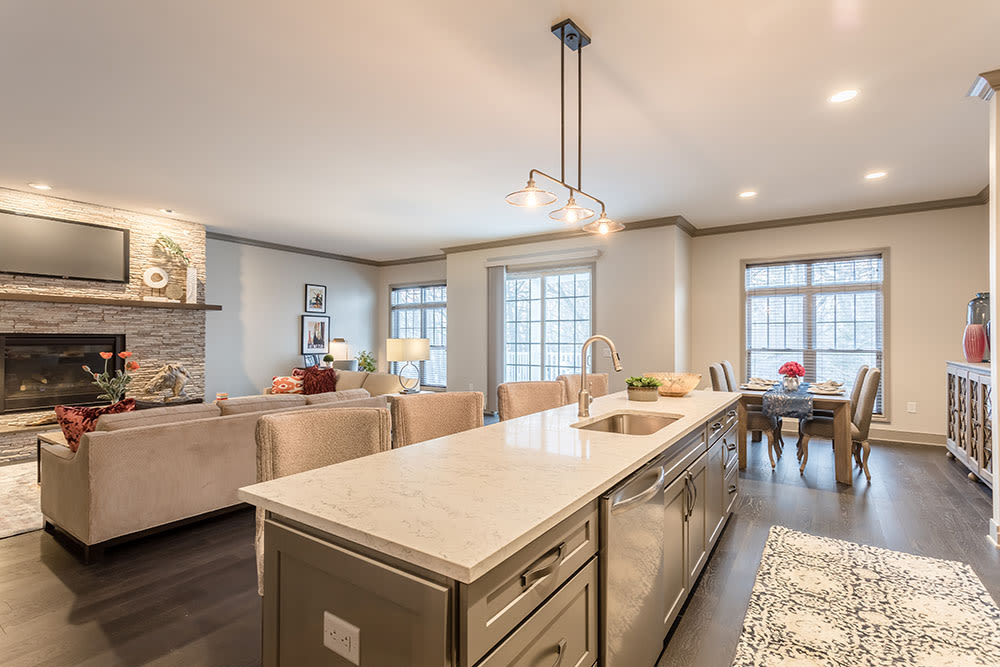 Beautiful apartments with modern living room, kitchen and dining room at Waters Edge Apartments in Webster, New York