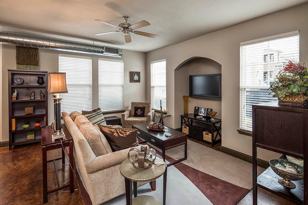 Spacious living room at Millennium Towne Center in Baton Rouge, LA