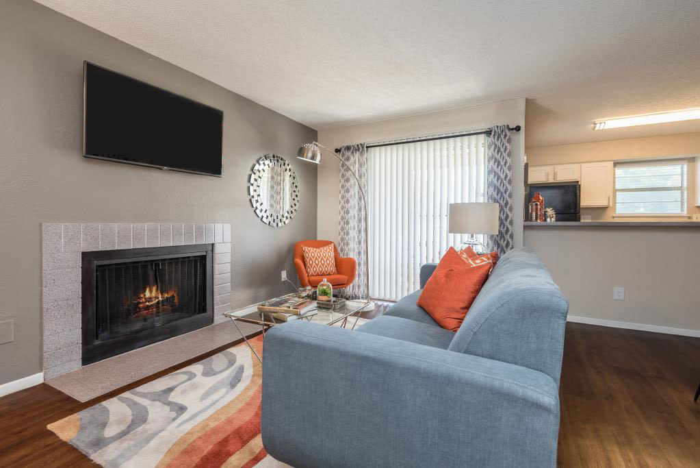 Modern decor and fireplace in living room at The Carling on Frankford in Carrollton, TX