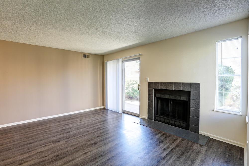 Spacious and equiped living room  at Deerfield Apartments in Denver, CO